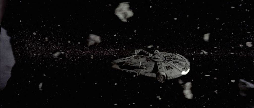 Millenium Falcon Passing an Asteroid Belt